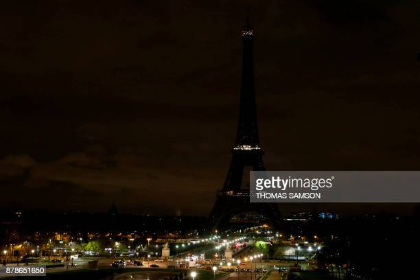 The lights of the Eiffel Tower in Paris are switched off on November 24 2017 in tribute to the victims of the deadly attack on a mosque in Egypt's...