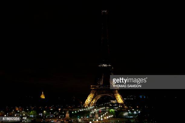 The lights of the Eiffel Tower in Paris are switching off on November 24 2017 in tribute to the victims of the deadly attack on a mosque in Egypt's...