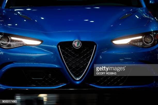 The lights on an Alpha Romeo Giulia are illuminated during the Press Preview at the 2018 North American International Auto Show in Detroit Michigan...