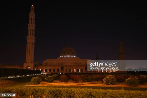 The lights on the Sultan Qaboos Grand Mosque are switched off for an hour in Muscut on March 25 as iconic landmarks and skylines are plunged into...