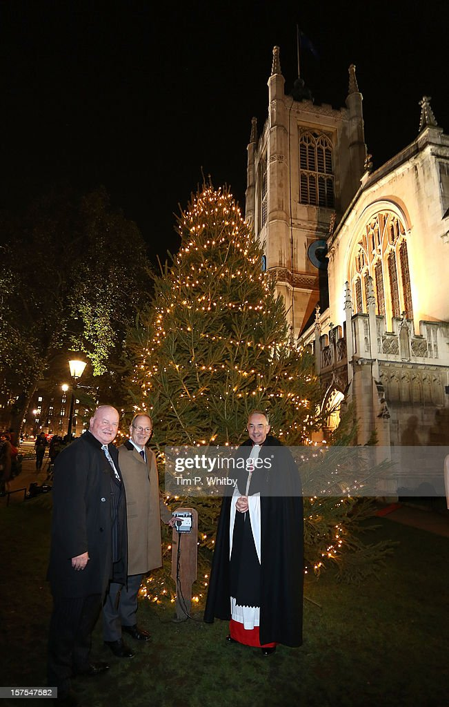 The lights on the Westminster Abbey Christmas Tree are switched on by The Very Reverend Dr John Hall (right) at Westminster Abbey on December 4, 2012 in London, England.