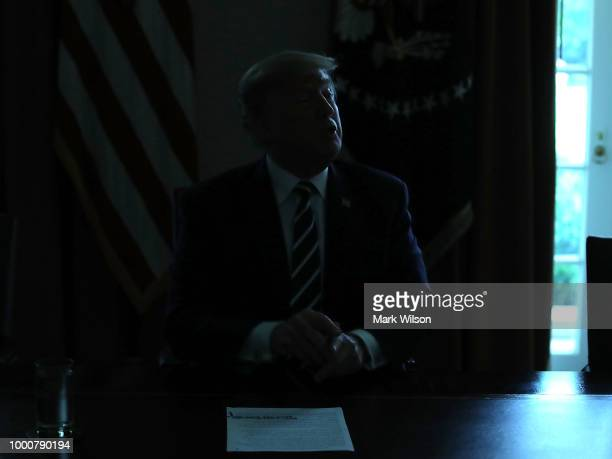 The lights temporarily go out in the Cabinet Room as US President Donald Trump talks about his meeting with Russian President Vladimir Putin during a...