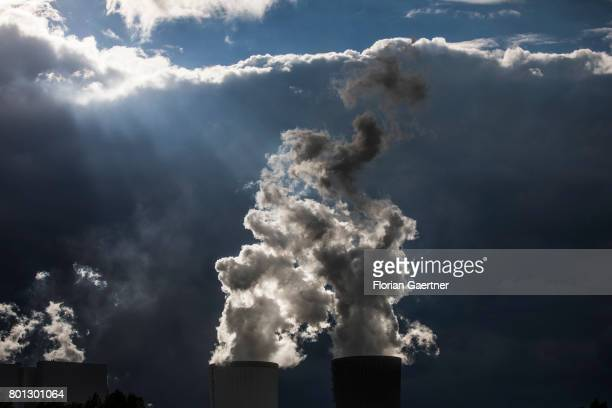 The lignitefired power station of Boxberg is captured in front of an upcoming thunderstorm on June 25 2017 in Boxberg Germany