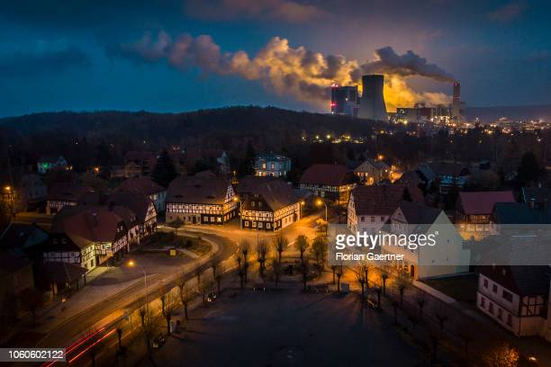 The lignitefired power station of the polish city Bogatynia is pictured behind the market square of the german village Hirschfelde on November 10...