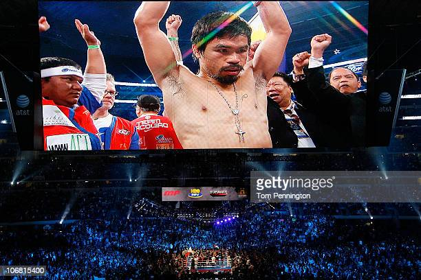 The likeness Manny Pacquiao of the Philippines is seen on the giant screen as he is introduced prior to fighting against Antonio Margarito of Mexico...