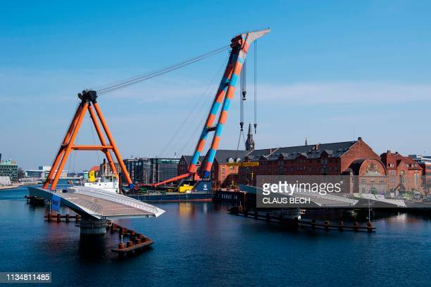The Lille Langebro bridge is mounted across the harbor in Copenhagen, on April 4, 2019 and will be opened for pedestrians and cyclists in autumn. /...