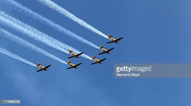 The Lima Lima Flight Team performs during the 55th Annual Chicago Air Water Show over North Avenue Beach in Chicago Illinois on AUGUST 17 2013