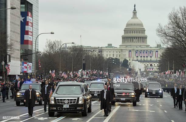 The limousine carrying President Donald Trump and first lady Melania Trump drives along the route of the inaugural parade flanked by security January...