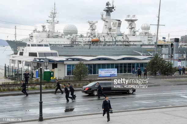 The limousine of North Korean leader Kim Jong Un drives away after a wreathlaying ceremony at a WWII memorial in the fareastern Russian port of...