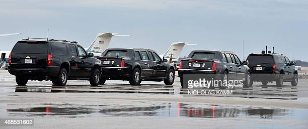 The limousine of US President Barack Obama and its decoy make their way to meet Obama shortly before Air Force One landed at Andrews Air Force Base...