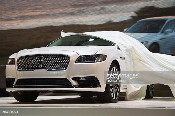 The Lincoln Continental is unveiled during the Lincoln press conference at the North American International Auto Show in Detroit Michigan January 12...
