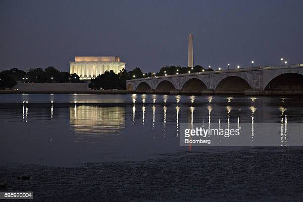 The Lincoln Memorial left and Washington Monument stand past the Arlington Memorial Bridge in Washington DC US on Thursday Aug 25 2016 House Speaker...
