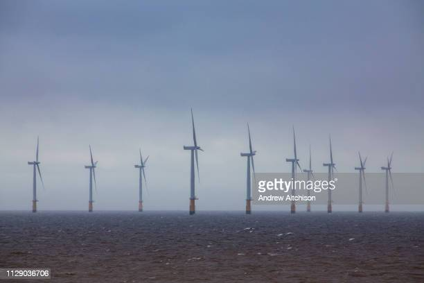 The Lincs Wind Farm breaking through the rain clouds It is a 270 MW offshore wind farm 8 kilometres off Skegness Lincolnshire on the east coast of...