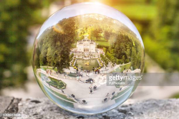 the linderhof castle through a lensball - pjphoto69 foto e immagini stock