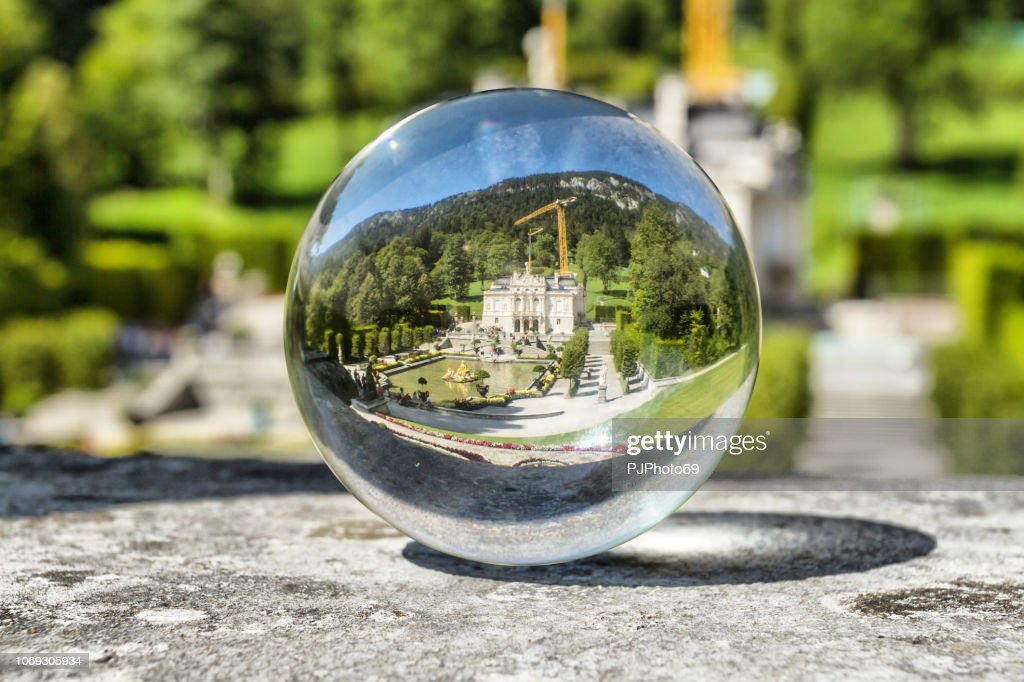 The Linderhof Castle through a lensball : Foto stock