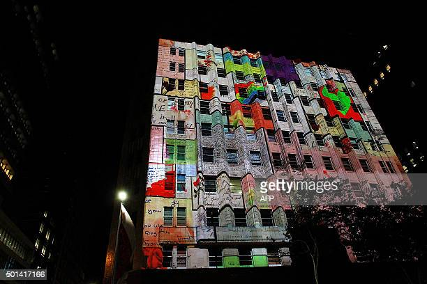 The Lindt Cafe building is illuminated to mark the one year anniversary of the Lindt Cafe siege in Sydney on December 15 2015 Australians marked the...
