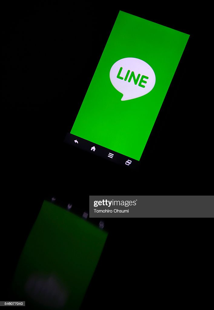 The Line Corp. logo is displayed on a smartphone in this arranged photograph on July 11, 2016 in Tokyo, Japan. Japanese messaging app provider LINE Corp., owned by South Korean portal Naver Corp., announced it has set the price of its initial public offering at 35 million shares at 3,300 yen apiece on Monday. The company expects to list on the New York Stock Exchange on July 14 and also on the Tokyo Stock Exchange on July 15.