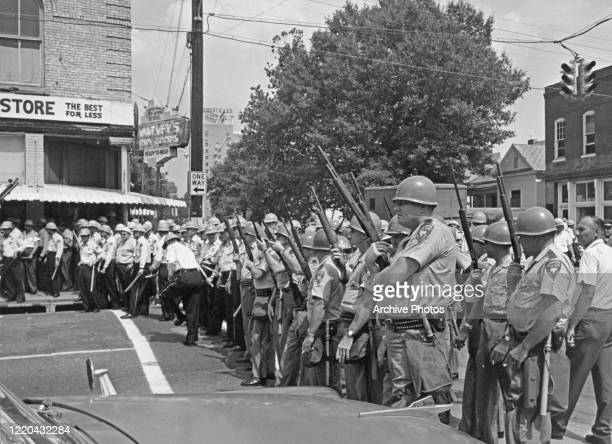 The line of armed police across the main street during the funeral procession of American civil rights activist Medgar Evers, who had been shot dead...