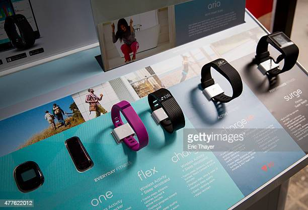 The line of Fitbit products are displayed during a lunchtime workout event outside the New York Stock Exchange during the IPO debut of the company on...