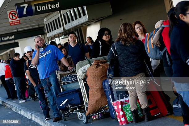 The line to reschedule cancelled or missed flights at the United terminal extends outside the terminal building as passengers are told the wait will...
