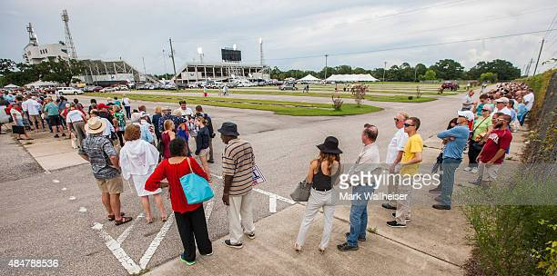The line to see Republican presidential candidate Donald Trump circles the block around LaddPeebles Stadium August 21 2015 in Mobile Alabama The...