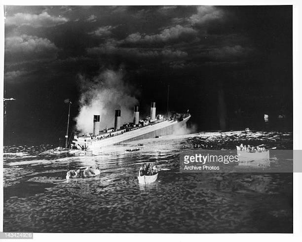 The liner RMS Titanic sinking in a scene from the film 'Titanic', directed by Jean Negulesco, 1953.