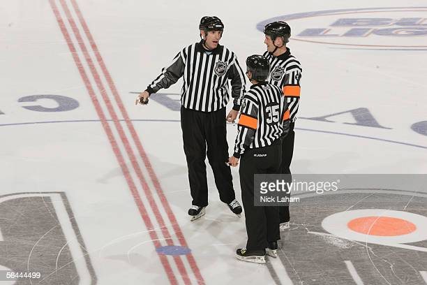 The linesman and referees talk at center ice during the NHL game between the Philadelphia Flyers and the Pittsburgh Penguins on November 16, 2005 at...