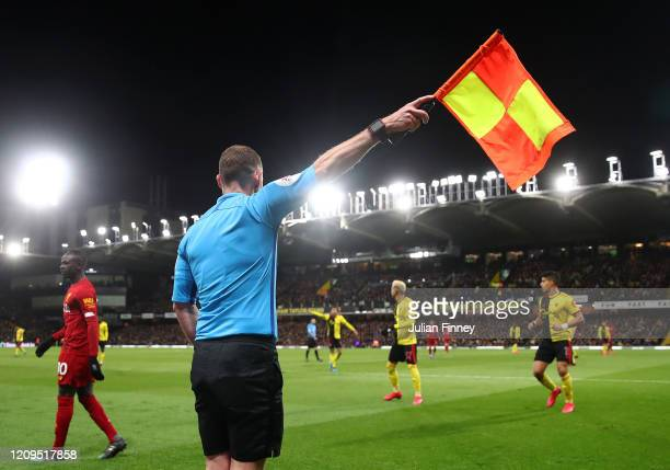 The linesman gives a decision during the Premier League match between Watford FC and Liverpool FC at Vicarage Road on February 29, 2020 in Watford,...