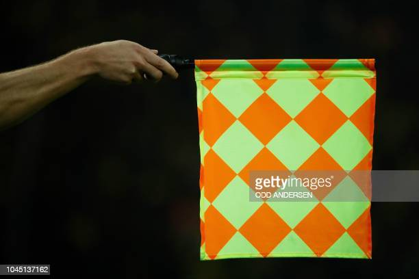 The linesman holds his flag for offside during the UEFA Champions League Group A football match BVB Borussia Dortmund v AS Monaco in Dortmund western...