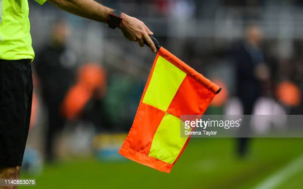 The Linesman holds the flag for offside during the Premier League match between Newcastle United and Crystal Palace at St James Park on April 06 2019...