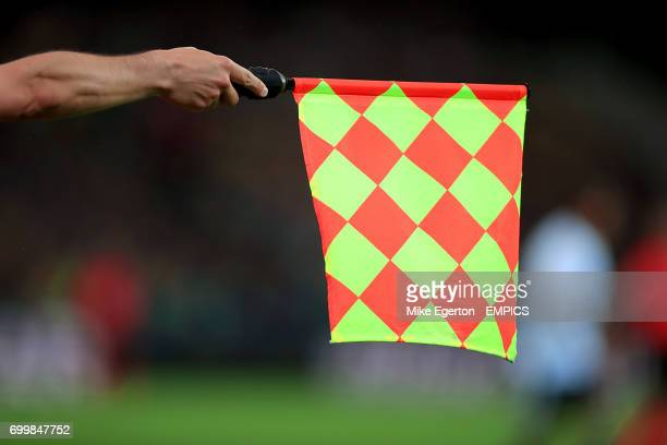 The linesman holds the offside flag