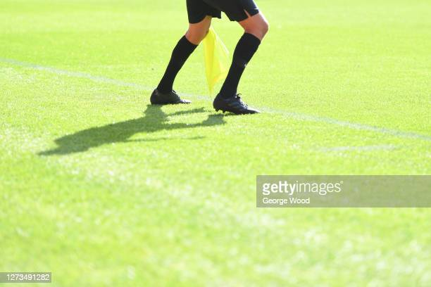 The linesman runs down the line during the Sky Bet League Two match between Harrogate Town and Walsall at The Keepmoat Stadium on September 19 2020...