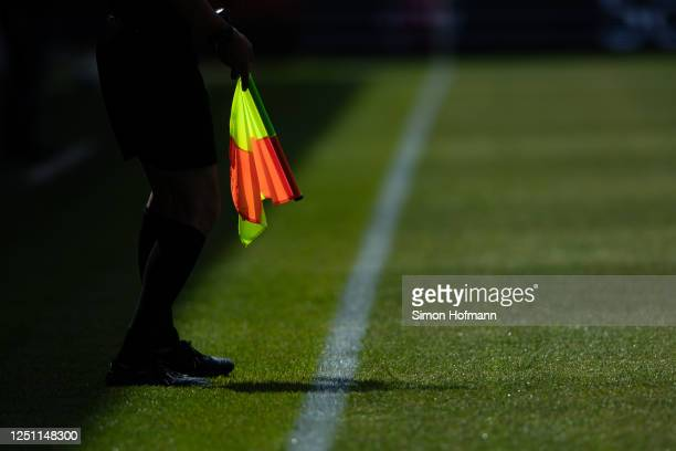 The linesman's flag is seen during the Second Bundesliga match between SV Sandhausen and SG Dynamo Dresden at BWT-Stadion am Hardtwald on June 21,...