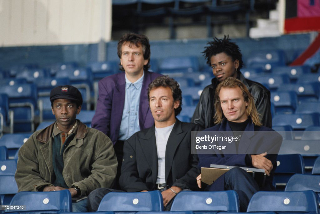 The line-up for the Human Rights Now! benefit concert for Amnesty International, 1988. From left to right (back row), Peter Gabriel and Tracy Chapman; (front row) Youssou N'Dour, Bruce Springsteen and Sting.
