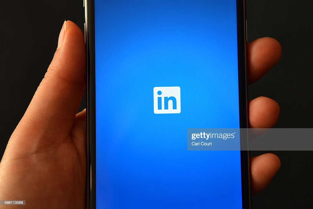 The LinkedIn logo is displayed on an iPhone on August 3, 2016 in London, England.