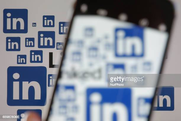 The LinkedIn social network for professionals app and logo is seen on various digital devices on 28 March 2017