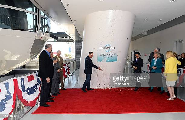 The LINQ Executive Project Director David Codiga breaks a bottle of champagne to open the Las Vegas High Roller at The LINQ on March 31 2014 in Las...