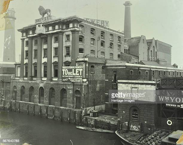 The Lion Brewery Belvedere Road Lambeth London 1928 View from Hungerford Bridge of the brewery with a statue of a lion on the roof and a 'To Let'...