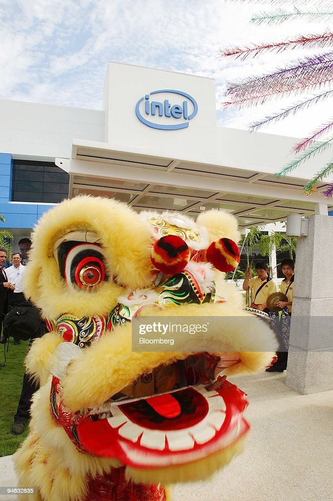 The Lion dance is performed outside of Intel Corp 's newly