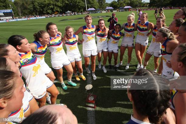 The Lions celebrate winning the Q Clash Cup during the round two AFLW match between the Brisbane Lions and the Gold Coast Suns at Hickey Park on...