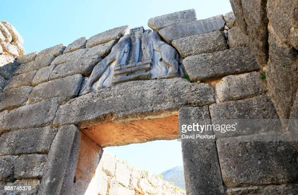 the lions' gate in the ruins of the ancient city of mycenae, unesco world heritage site, peloponnese, greece, europe - the lions stock photos and pictures