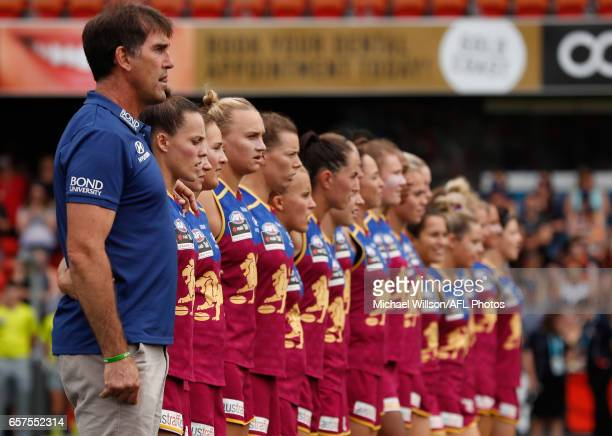 The Lions line up for the national anthem during the 2017 AFLW Grand Final match between the Brisbane Lions and the Adelaide Crows at Metricon...