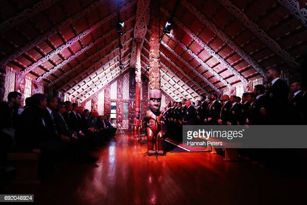 The Lions team sing in the meeting house during the British Irish Lions Maori Welcome at Waitangi Treaty Grounds on June 4 2017 in Waitangi New...