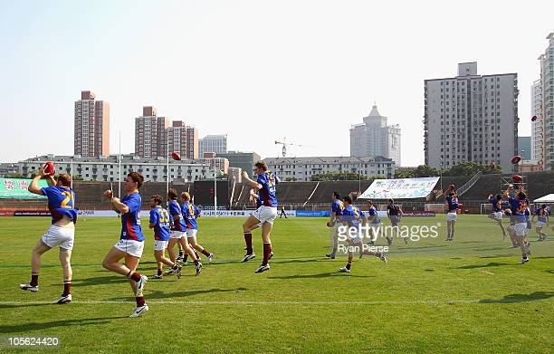 The Lions warm up prior to the AFL Kaspersky Cup Shanghai Showdown match between the Brisbane Lions and the Melbourne Demons at Jiangwan Sports...