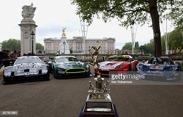 The Lister Storm, Aston Martin Racing DBR9, Larbre Ferrari 550 Maranello and the JMB Racing Maserati MC12 with the Tourist Trophy in the foreground...