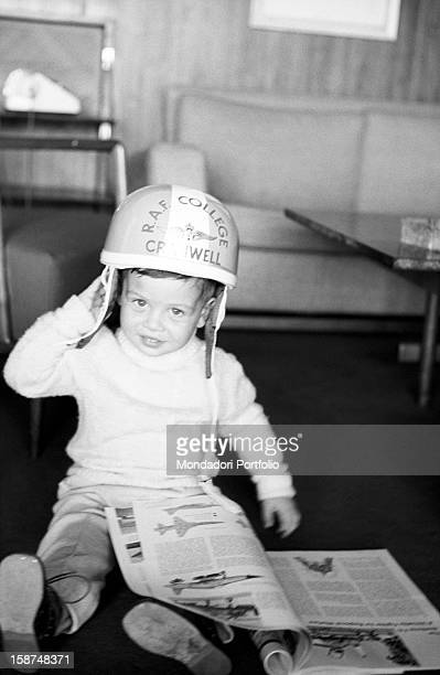 The little Abdullah II son of Hussein of Jordan and Muna alHussein leafing through an illustrated book Jordan 24th March 1964