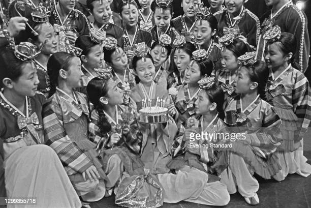 The Little Angels Children's Folk Ballet of Korea celebrate the birthday of one of their members, UK, 23rd November 1972. They are a South Korean...