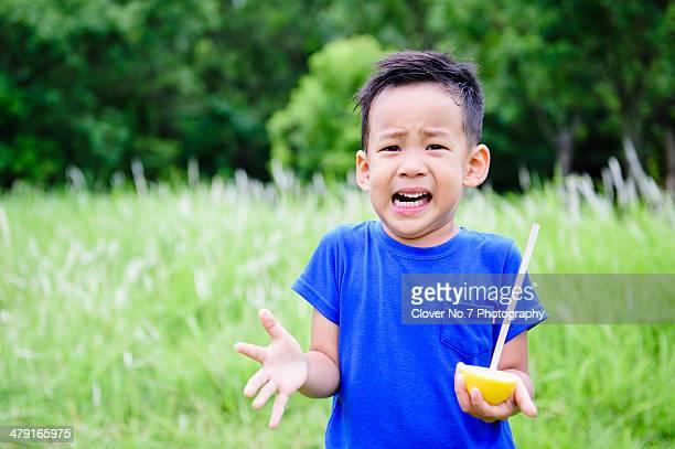 The little boy felt very sour lemon