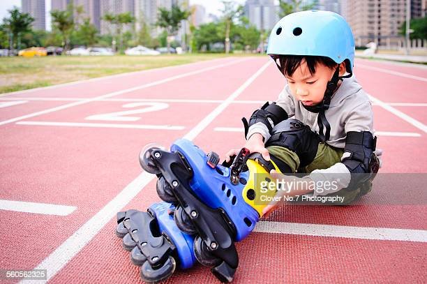 The little boy wearing roller-blades.