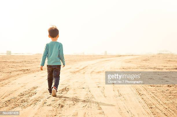 The little boy who walked on the road.